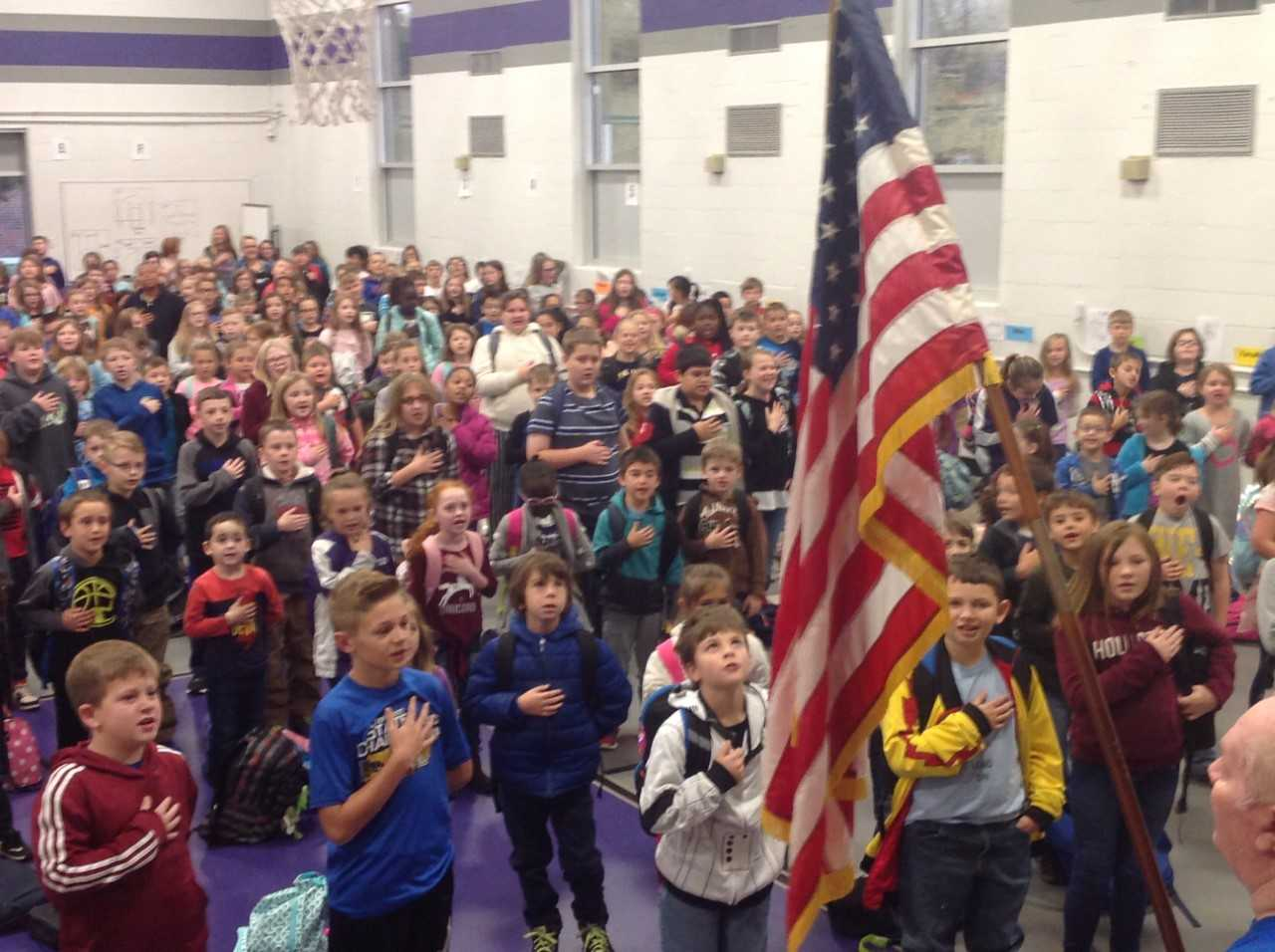 WHE students participate in the Pledge of Allegiance